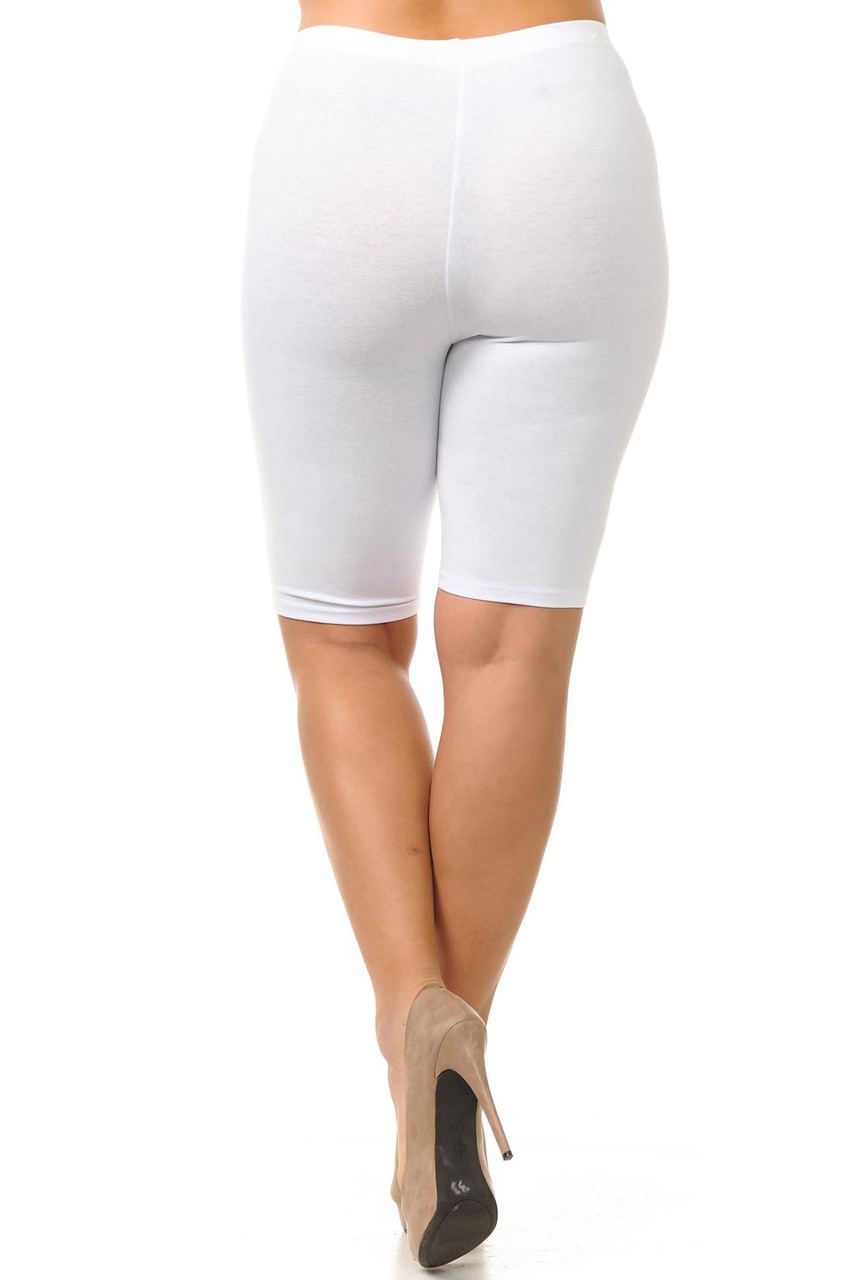 Back view image of white plus size thigh length USA cotton shorts with a crossed leg.