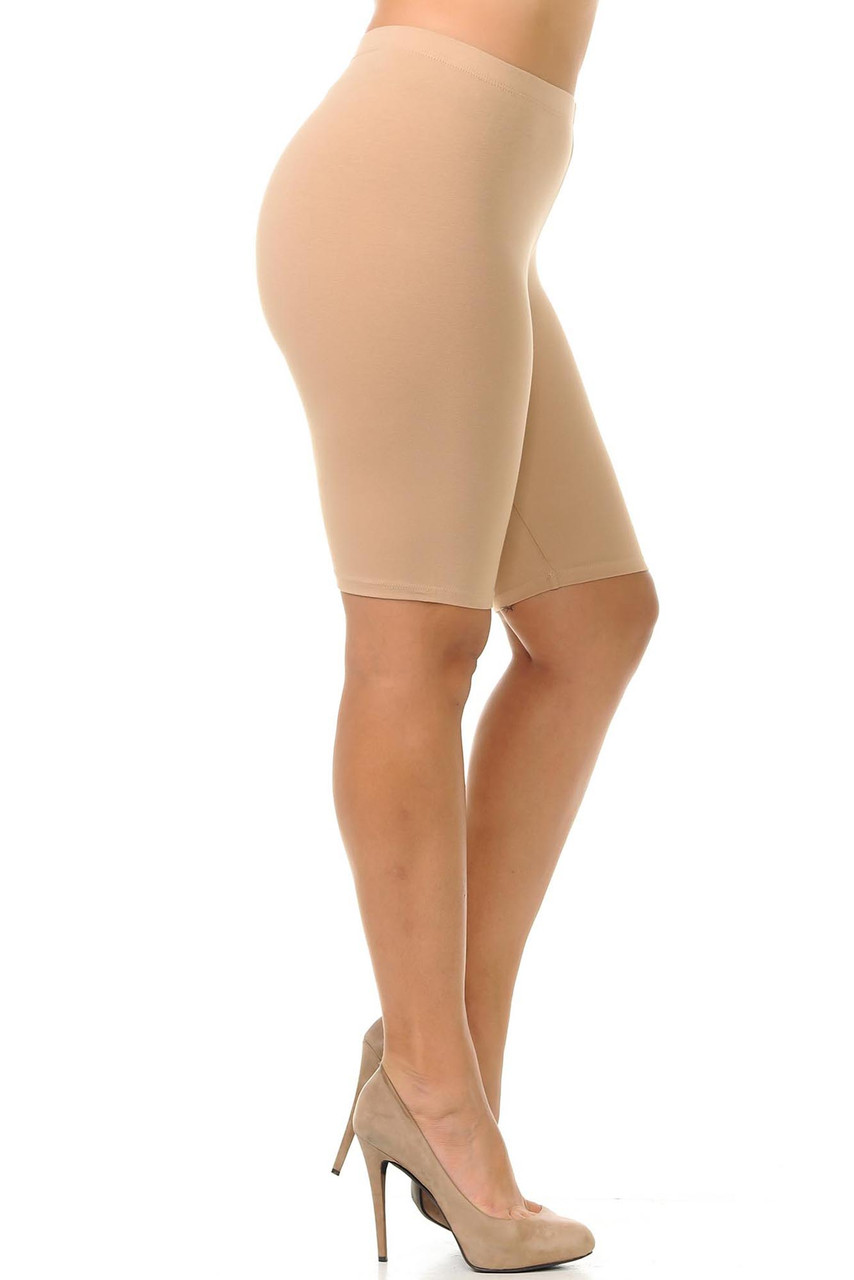 Right side view of beige body hugging made in the USA cotton bike shorts.