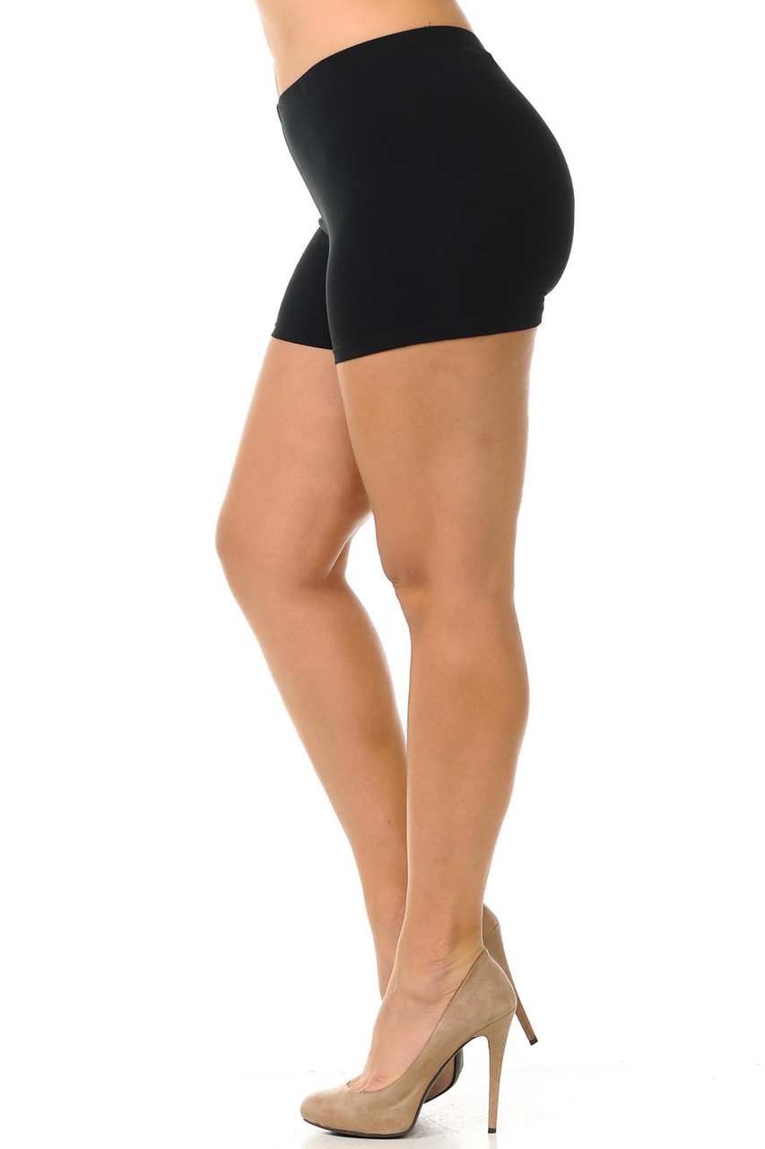 Left side view of basic black plus size cotton boy shorts with an elastic waistband that comes up to about mid rise.