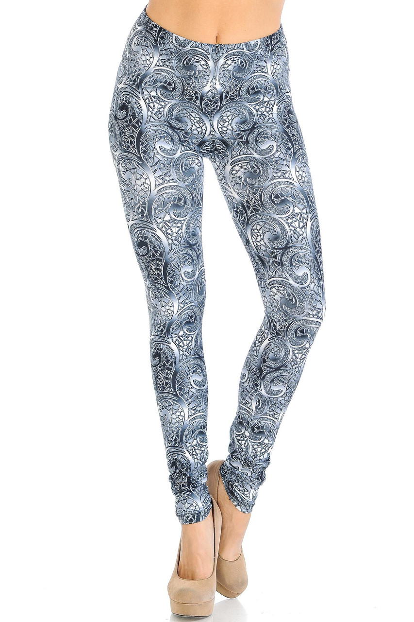 Front crossed foot view of Creamy Soft Swirling Crystal Glass Leggings - USA Fashion™ with an elastic stretch waistband that comes up to about mid rise.
