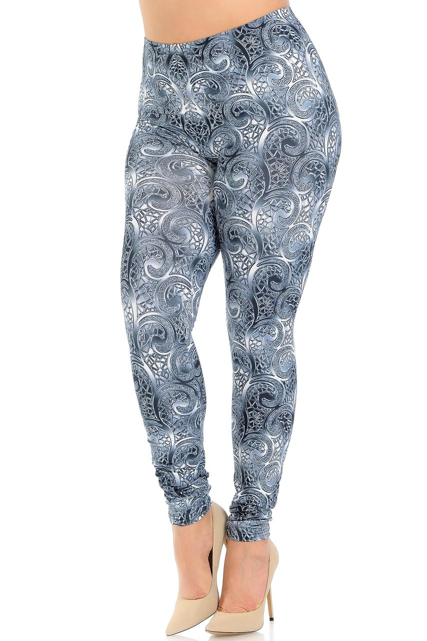 Angled front view of Creamy Soft Swirling Crystal Glass Plus Size Leggings - USA Fashion™ featuring a chrome like abstract swirl that adds elegant interest to any ensemble, dressy or casual.
