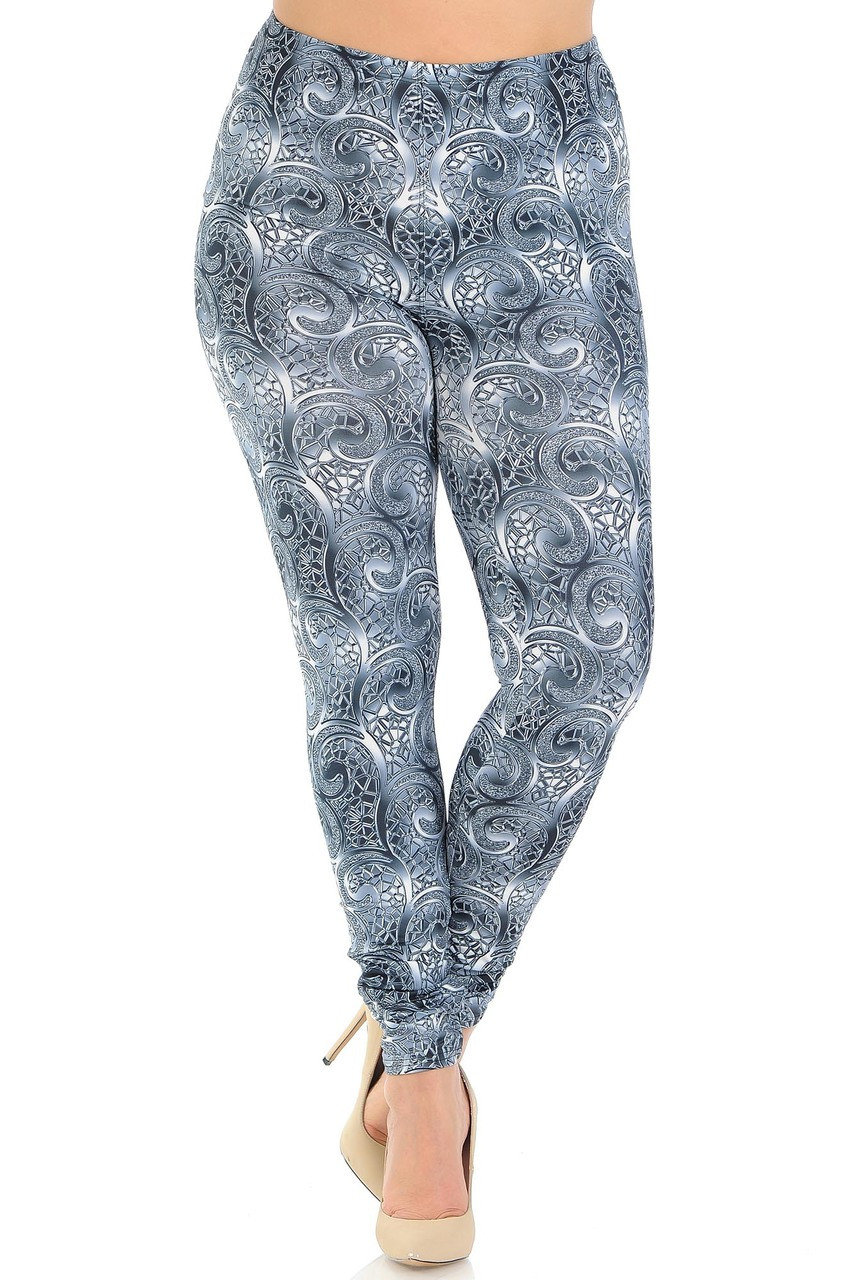 Front crossed foot view of Creamy Soft Swirling Crystal Glass Plus Size Leggings - USA Fashion™ with an elastic stretch waistband that comes up to about mid rise.