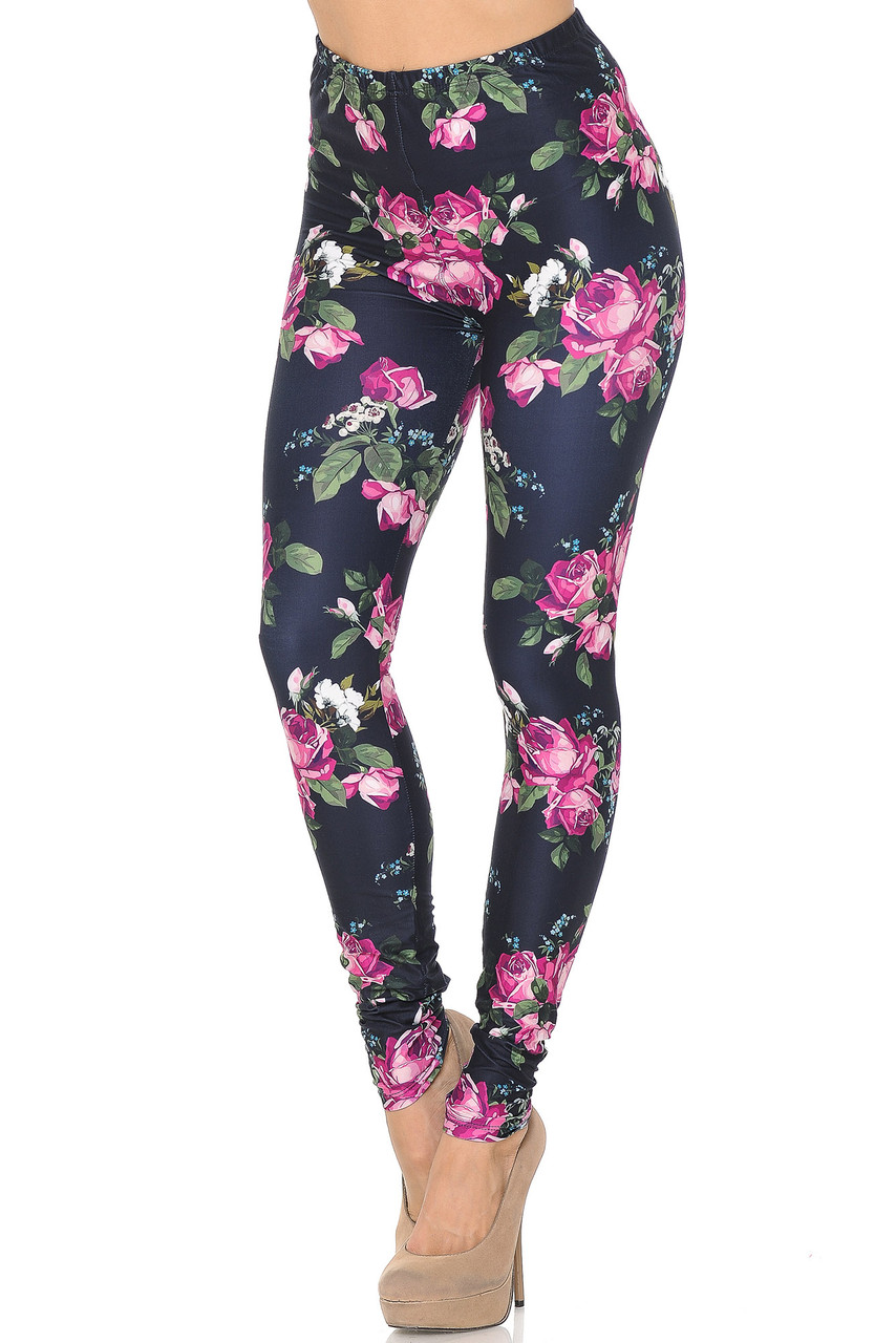 Angled front view of our beautiful Creamy Soft Fuchsia Rose Extra Small Leggings - USA Fashion™ with a lovely pink rose design with green leaves that boldly contrasts a black background.