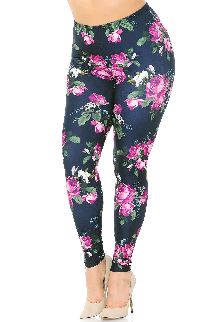 Angled front view of our beautiful Creamy Soft Fuchsia Rose Extra Plus Size Leggings - 3X-5X - USA Fashion™ with a lovely pink rose design with green leaves that boldly contrasts a black background.