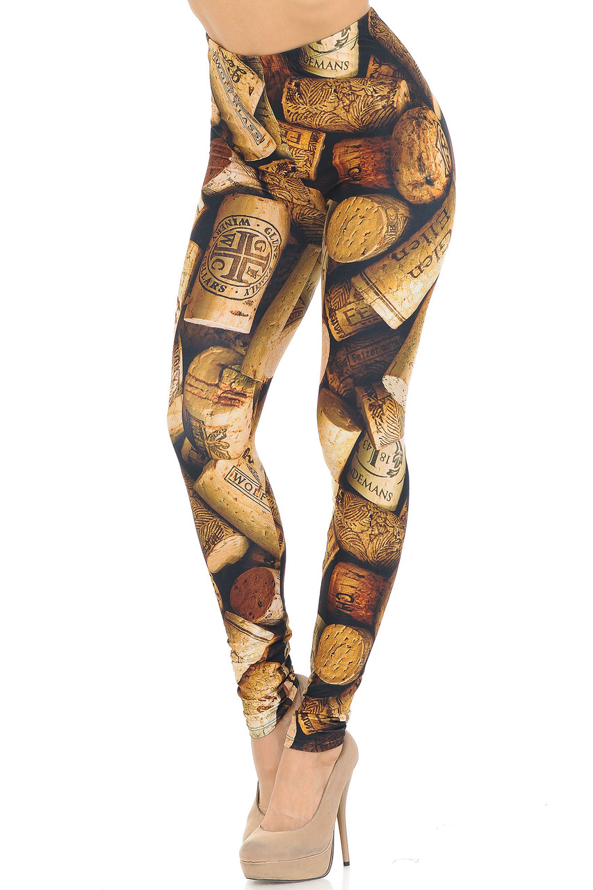 Left side right knee bent view of Creamy Soft Wine Cork Leggings  - USA Fashion™ showcasing an all over photorealistic vino cork print, ideal for any aficionado.