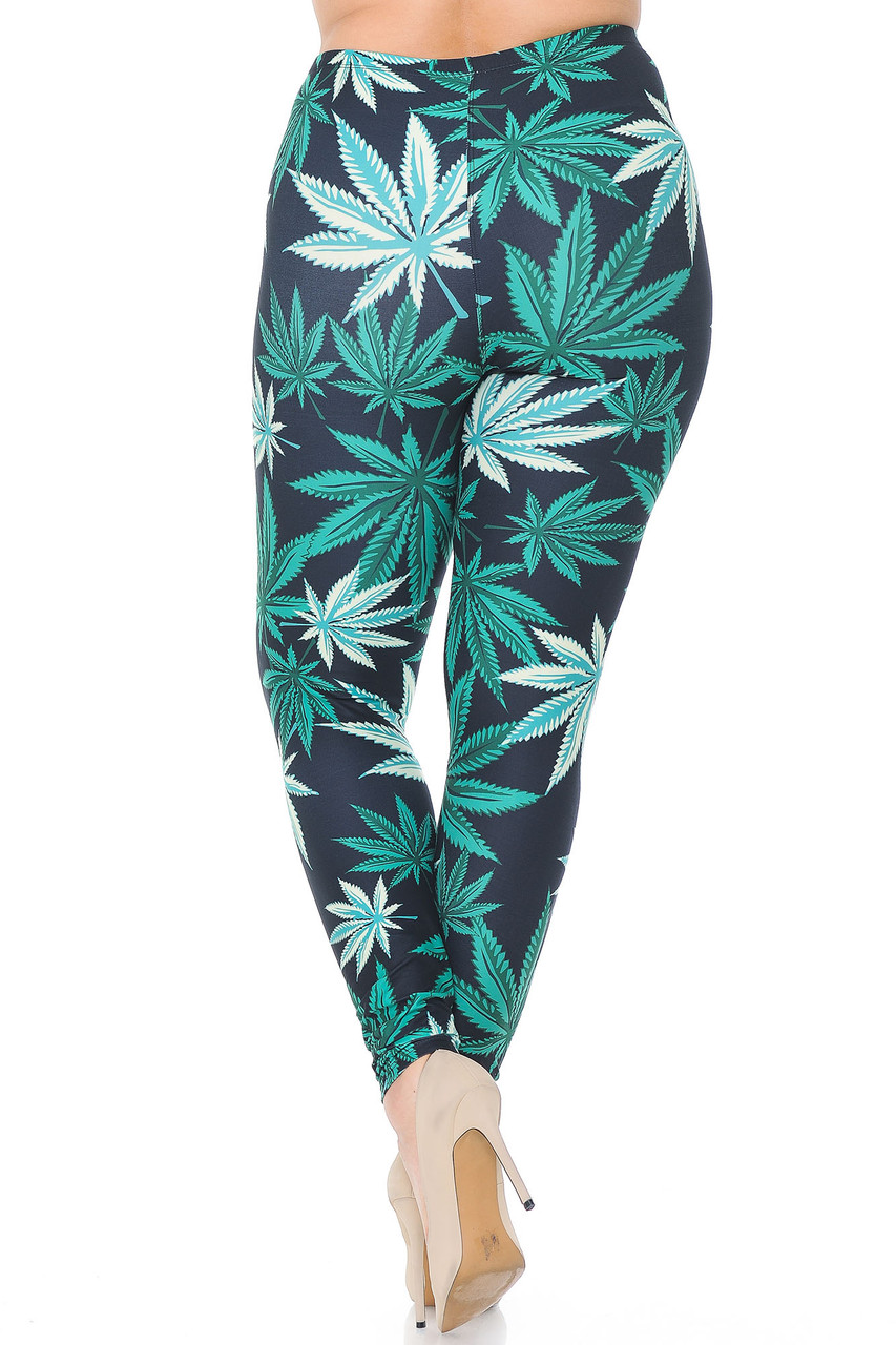 Rear view of Creamy Soft Black Weed Plus Size Leggings - USA Fashion™ showing off the flattering body hugging fit and continued all over design.