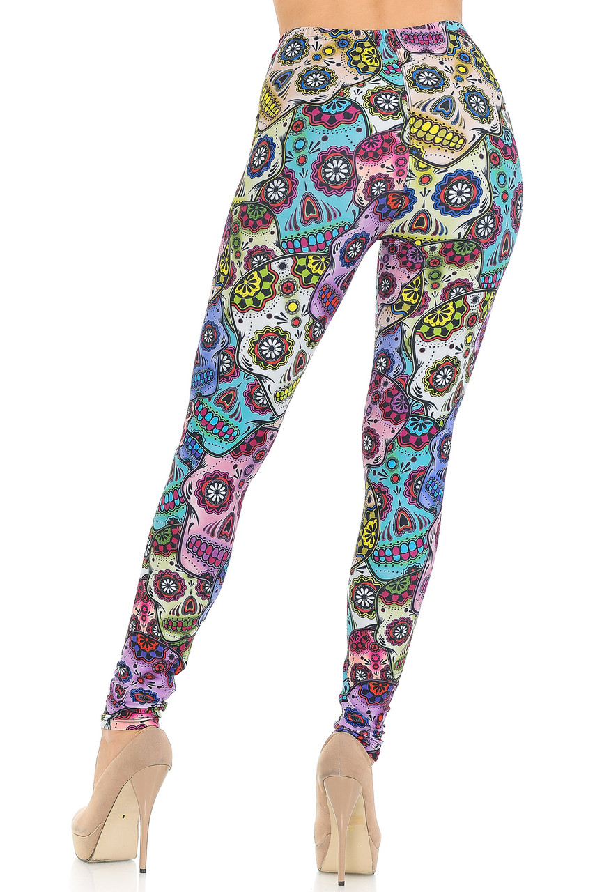 Rear view of our body hugging figure flattering Creamy Soft Sugar Skull Extra Small Leggings - USA Fashion™ showing off the continued 360 degree eye-catching print.