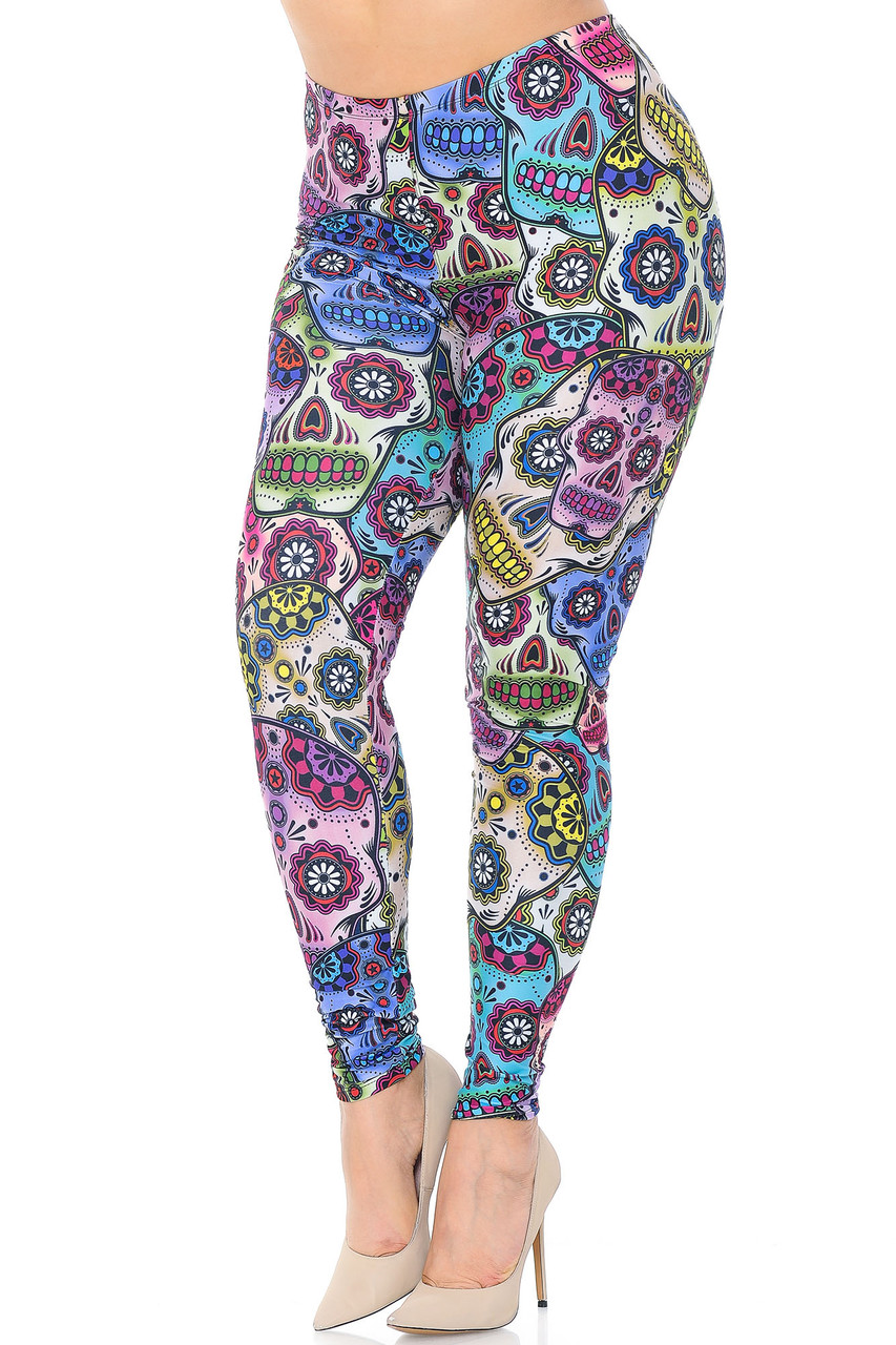 Angled front view image of Creamy Soft Sugar Skull Extra Plus Size Leggings - 3X-5X with a colorful all over day of the dead themed skeleton head print with floral accents.
