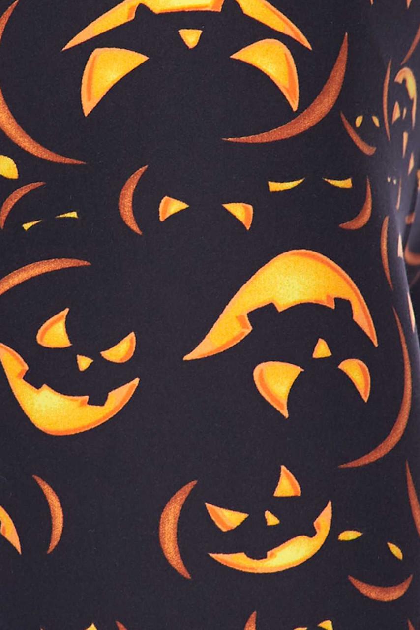 Close up fabric swatch of Buttery Soft Evil Halloween Pumpkins Kids Leggings