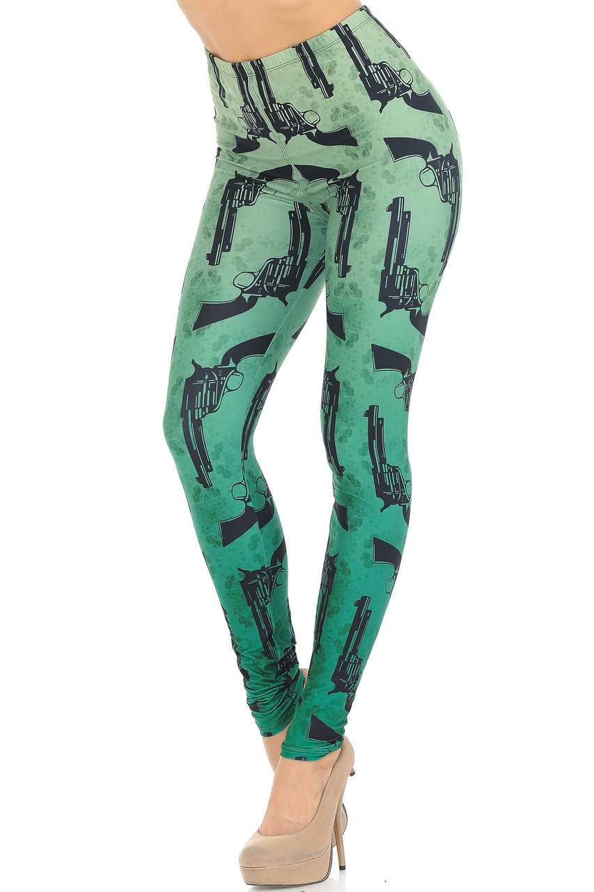 Angled front view Creamy Soft Ombre Green Guns Leggings featuring a light to darker green ombre colored background with an all over black pistol print.
