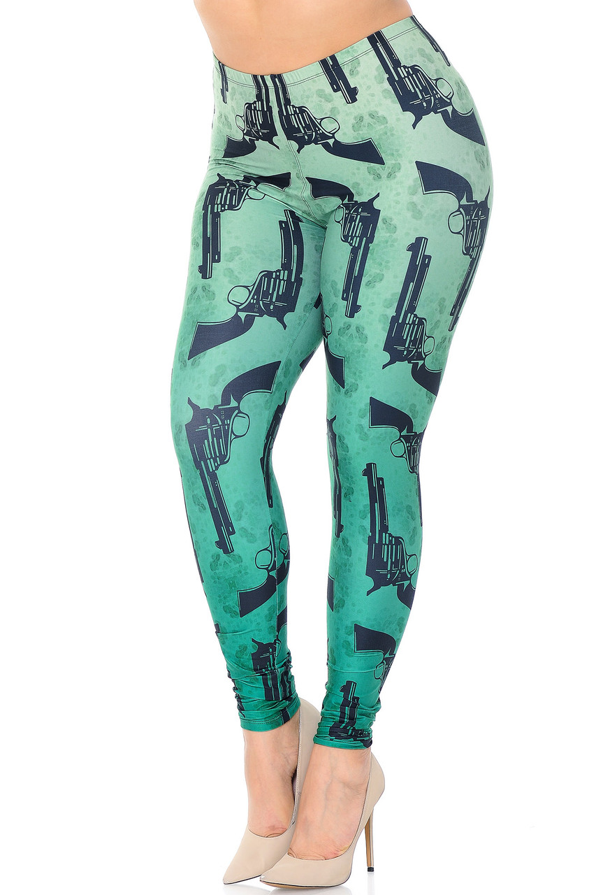 Angled front view Creamy Soft Ombre Green Guns Extra Plus Size Leggings - 3X-5X featuring a light to darker green ombre colored background with an all over black pistol print.