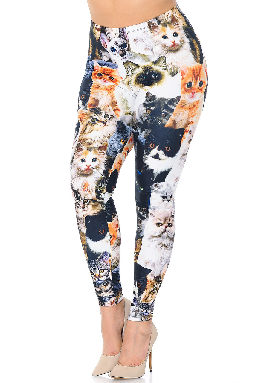 Angled front/partial left view of Creamy Soft Cat Collage Extra Plus Size Leggings - 3X-5X - USA Fashion™ featuring an all over design that features kitty faces in a variety of breeds.