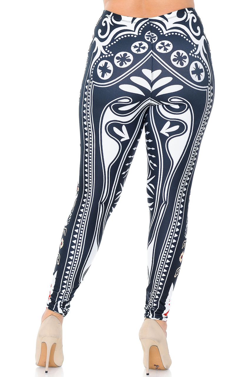 Back view of Creamy Soft Queen of Hearts Plus Size Leggings - USA Fashion™ showing a black and white decorative design inspired by playing card decorative details.