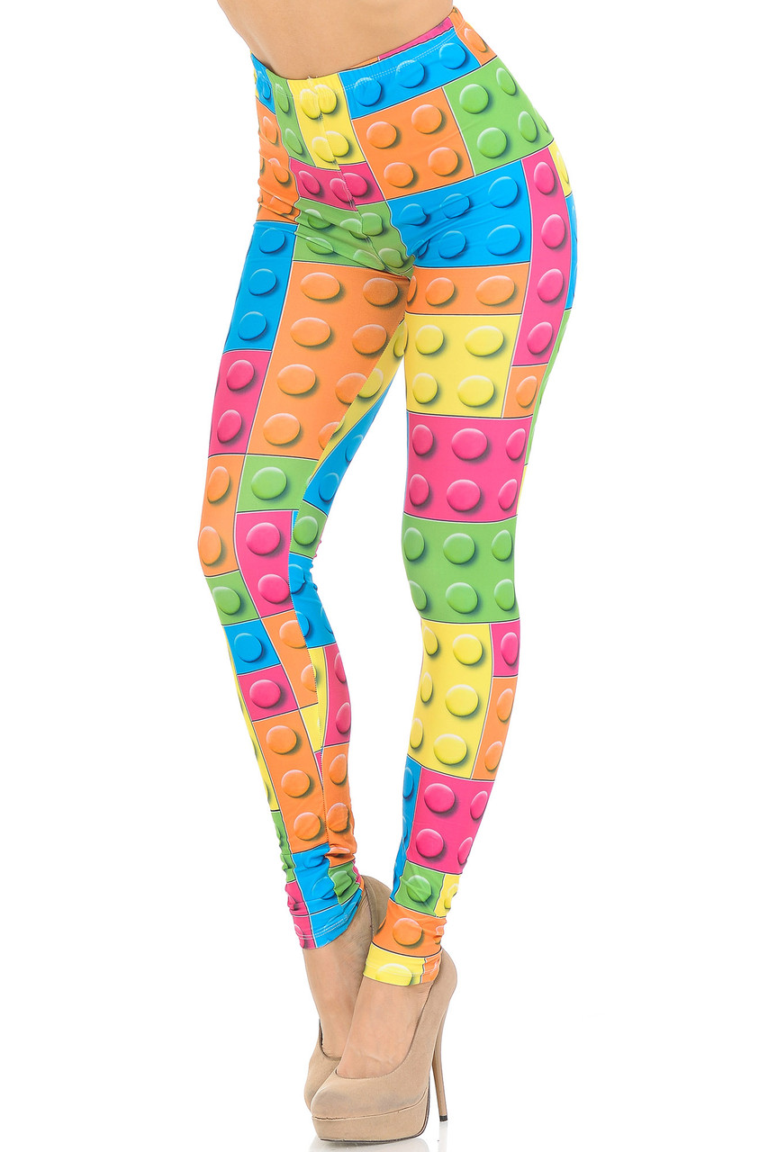 Partial front/left side view of Creamy Soft Lego Leggings - USA Fashion™  featuring a colorful all over block design that brings a fun and youthful aesthetic to any outfit.