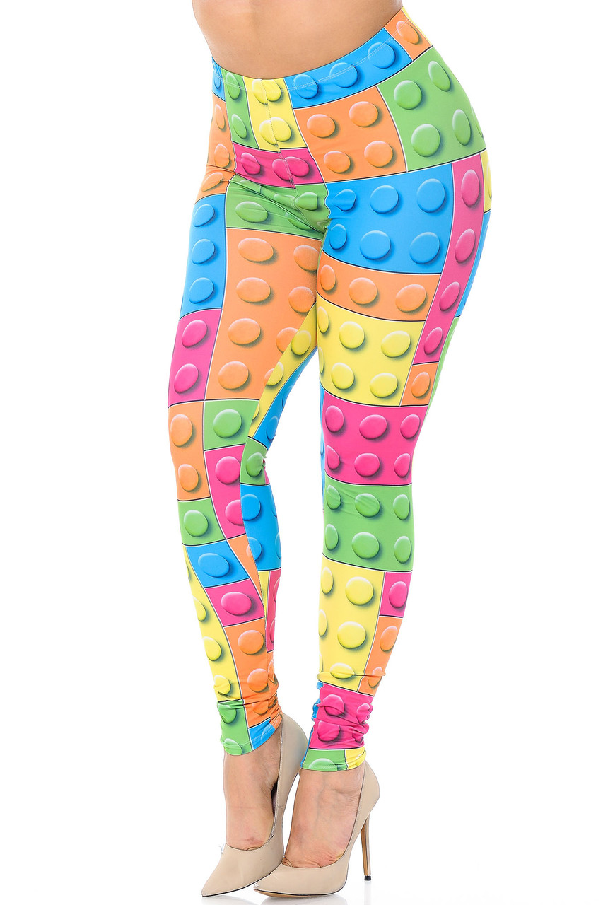 Angled front view of Creamy Soft Lego Extra Plus Size Leggings - 3X-5X - USA Fashion™ featuring a colorful all over block design that brings a fun and youthful aesthetic to any outfit.