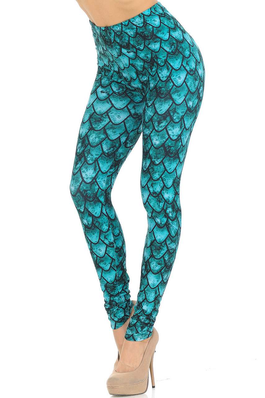 Left side right knee bent view of our Creamy Soft Green Scale Extra Small Leggings - USA Fashion™ with an all over scale design that will transform you into a different creature such as a mermaid or dragon, ideal for Hallowen and fun stand out looks.