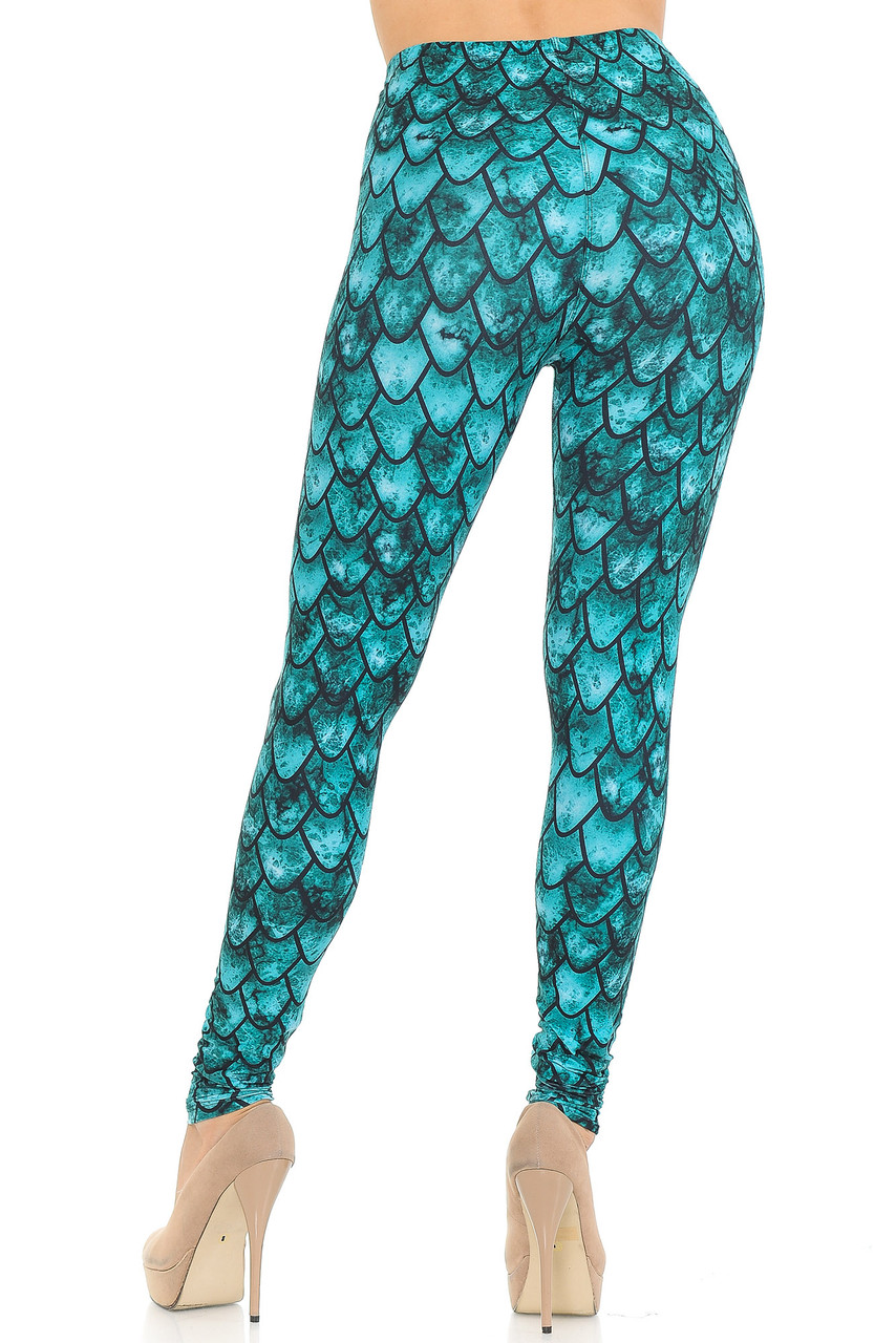 Rear view of our Creamy Soft Green Dragon Extra Small Leggings - USA Fashion™ showing off a flattering figure hugging fit.
