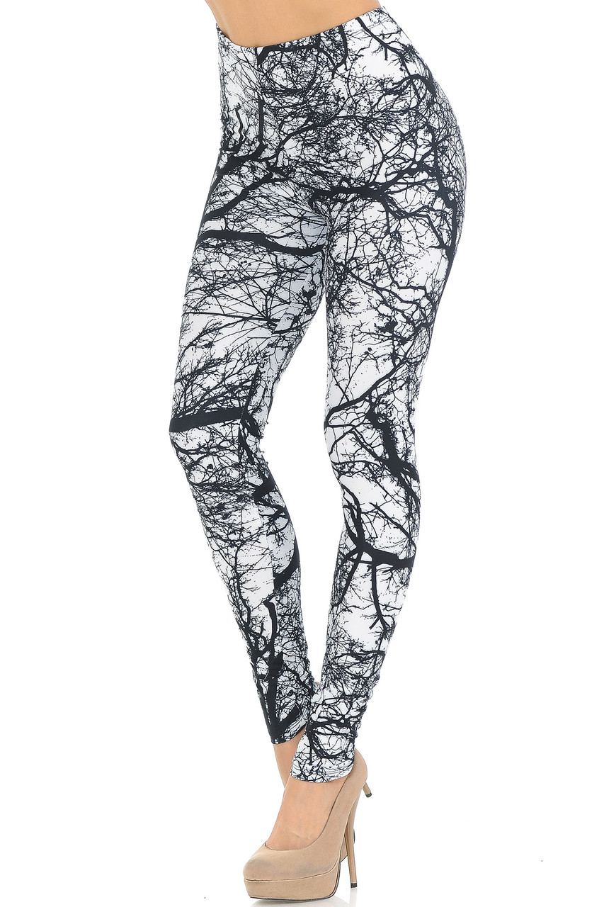 These Creamy Soft Photo Negative Tree Extra Small Leggings - USA Fashion™ feature a cool neutral black on white tree branch image, perfect for any nature lover.