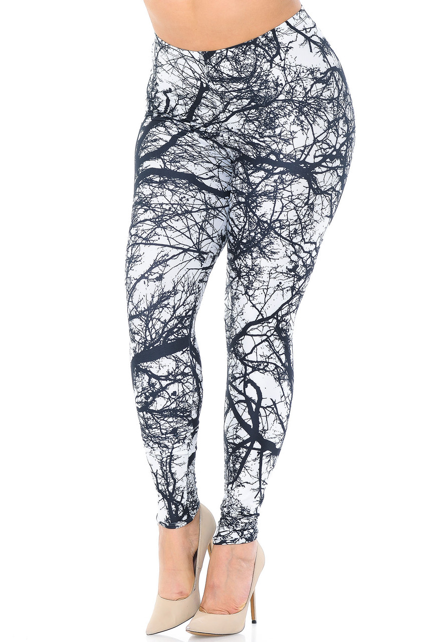 These Creamy Soft Photo Negative Tree Plus Size Leggings - USA Fashion™ feature a cool neutral black on white tree branch image, perfect for any nature lover.