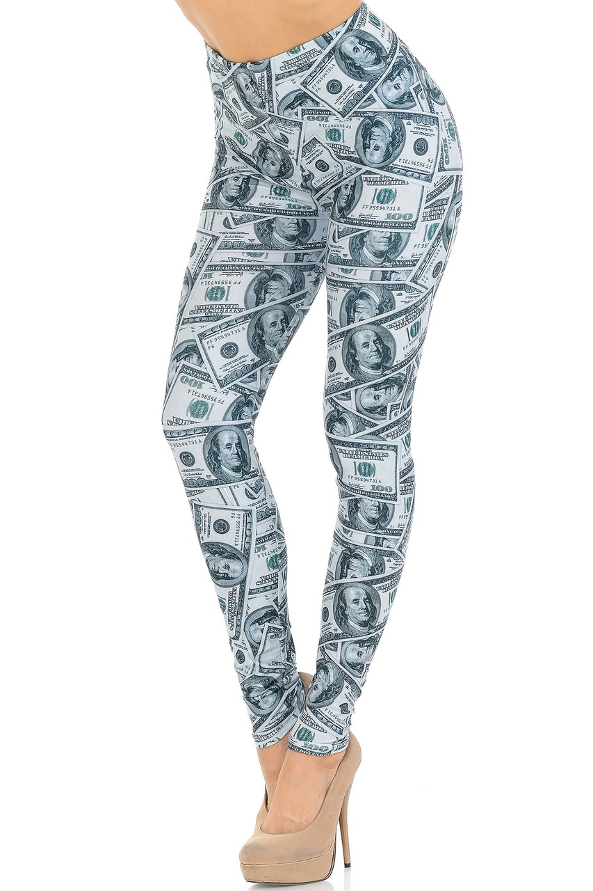 Angled front view image of our Creamy Soft Raining Money Leggings - USA Fashion™ featuring a sassy and eye-catching collage style print of 100 dollar bills.