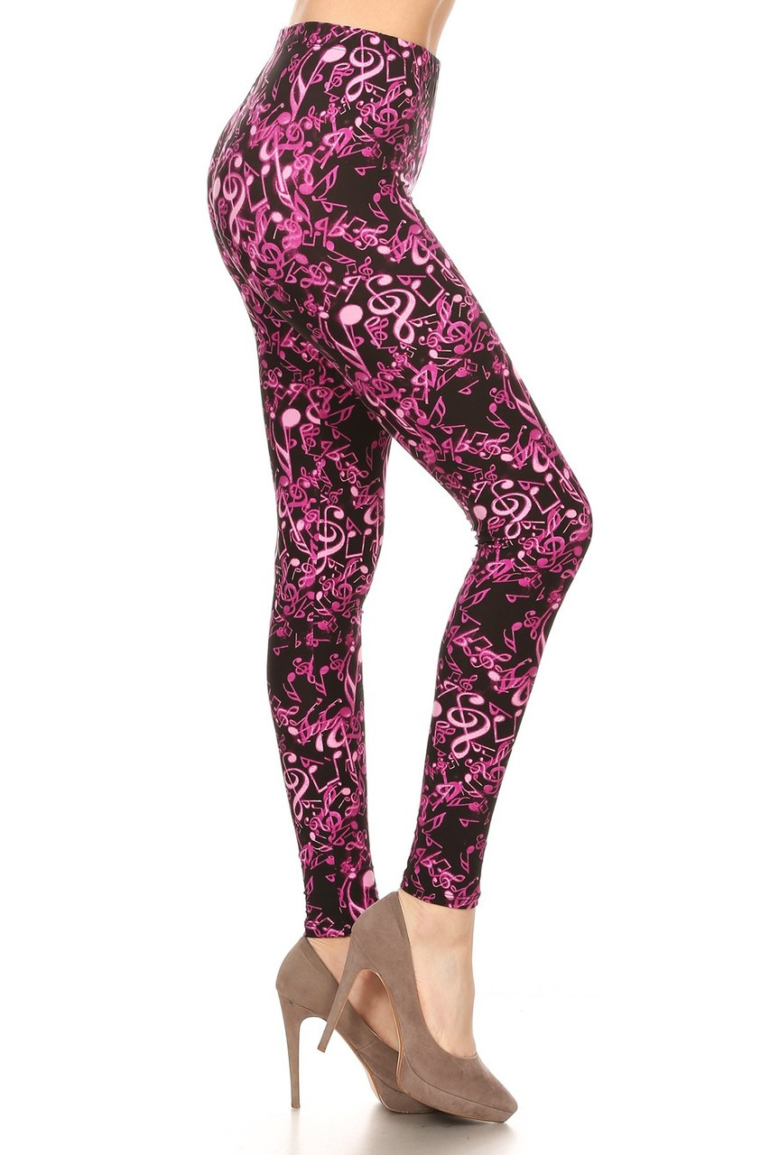 Right side view image of our Buttery Soft Electric Fuchsia Music Note Leggings featuring a vibrant pink on black musical note design.