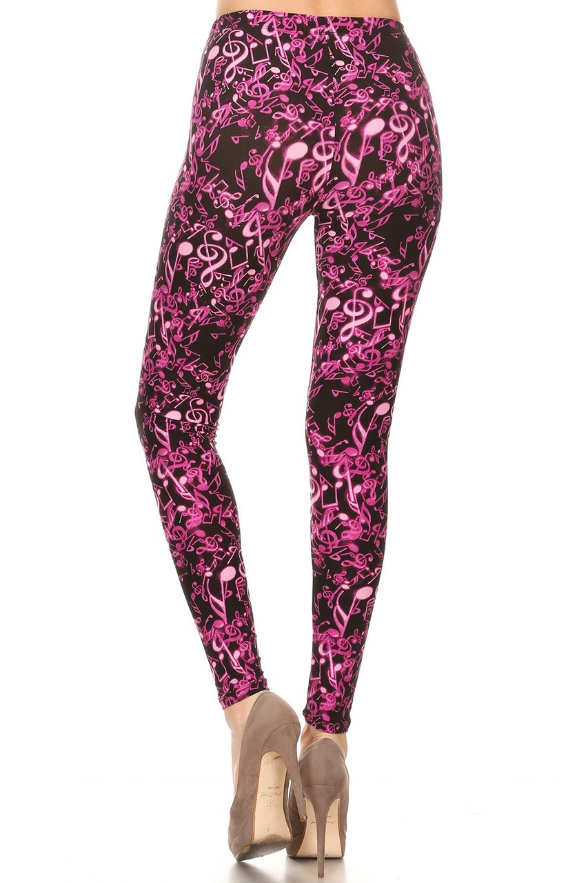 Rear view image of our eye-catching Buttery Soft Electric Fuchsia Music Note Plus Size Leggings that are the perfect addition to brighten up any musician or fan's wardrobe.