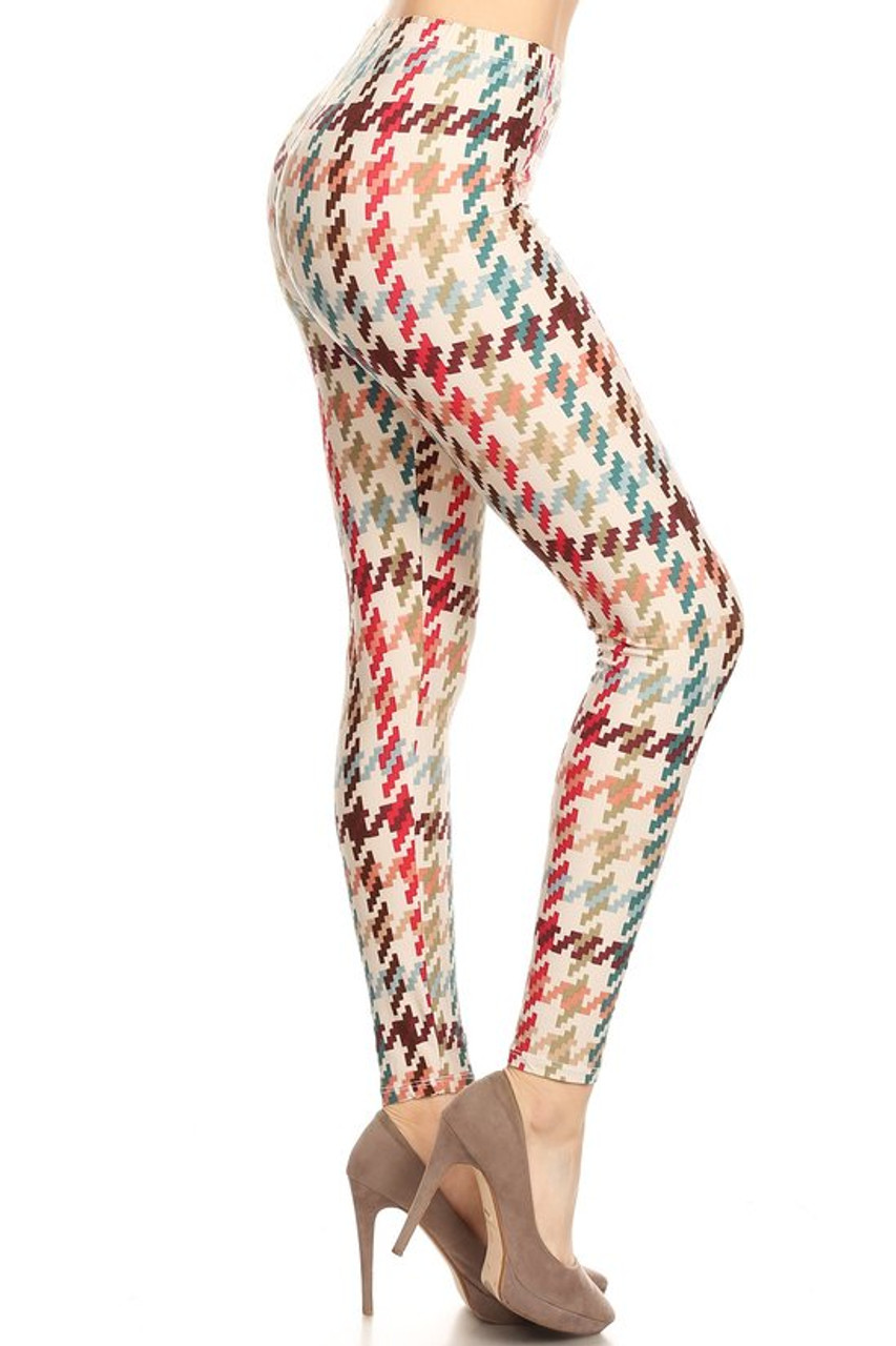 Right side view image of our Buttery Soft Earth Tone Pixel Zags Plus Size Leggings with a retro muted tone larger scale houndstooth striped design i brown, nude, red, and blue tones on a white background.