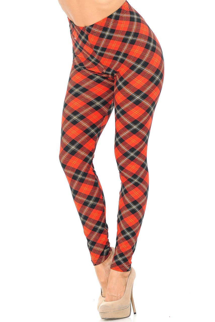 Angled front view image of Buttery Soft Classic Red Plaid Leggings featuring a diagonally oriented black accented Clan Wallace style design .