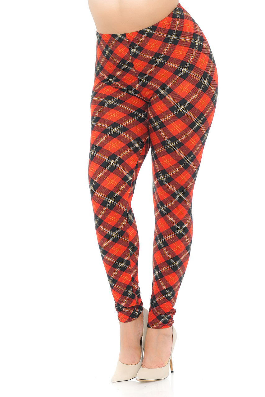 Angled front view image of Buttery Soft Classic Red Plaid Extra Plus Size Leggings featuring a diagonally oriented black accented Clan Wallace style design .
