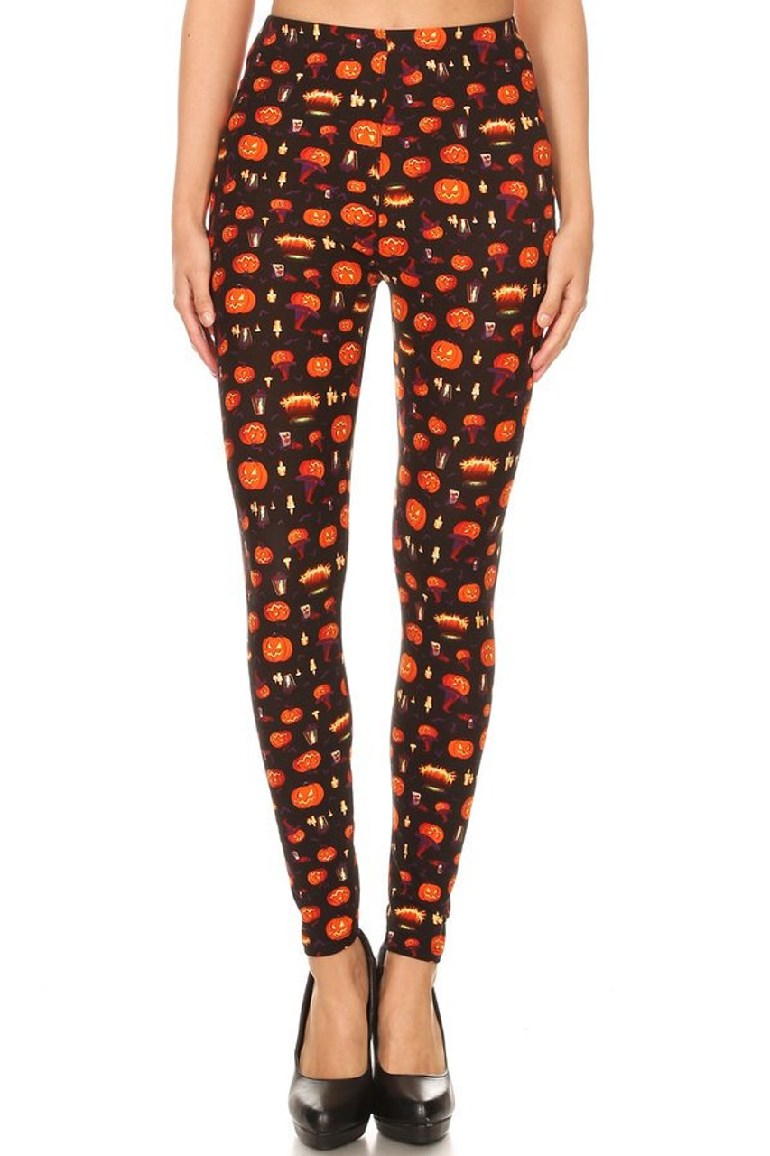 Front view image of our festive Buttery Soft Pumpkins Cauldrons and Candles Halloween Leggings featuring an all over print of brightly lit orange Jack-O-Lanterns, candles, cauldrons, bats, witch hats, and lanterns contrasting a black background.