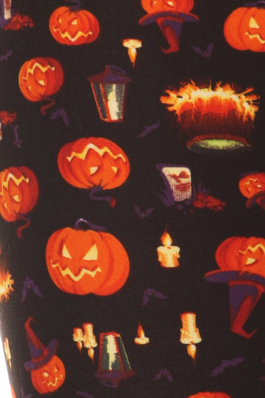 Close up fabric swatch of Buttery Soft Pumpkins Cauldrons and Candles Halloween Leggings