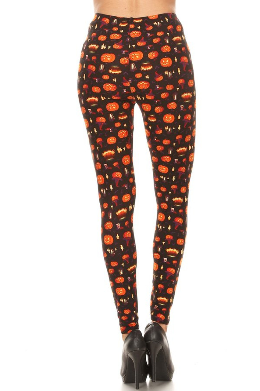 Rear view image of our spooky themed figure flattering Buttery Soft Pumpkins Cauldrons and Candles Halloween Plus Size Leggings perfect for October holiday fashion looks.