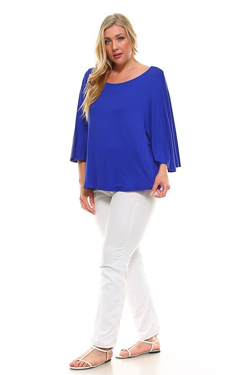 Full body image of Round Neckline 3/4 Flutter Sleeve Relaxed Fit Rayon Plus Size Top shows styled with white skinny leg pants and white sandals.
