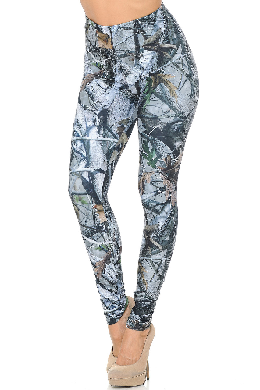 Angled front view image of our Creamy Soft Camouflage Trees Leggings - USA Fashion™ featuring a super cool photorealistic nature inspired gray toned tree and branch design with sparsely placed brown and green leaves.