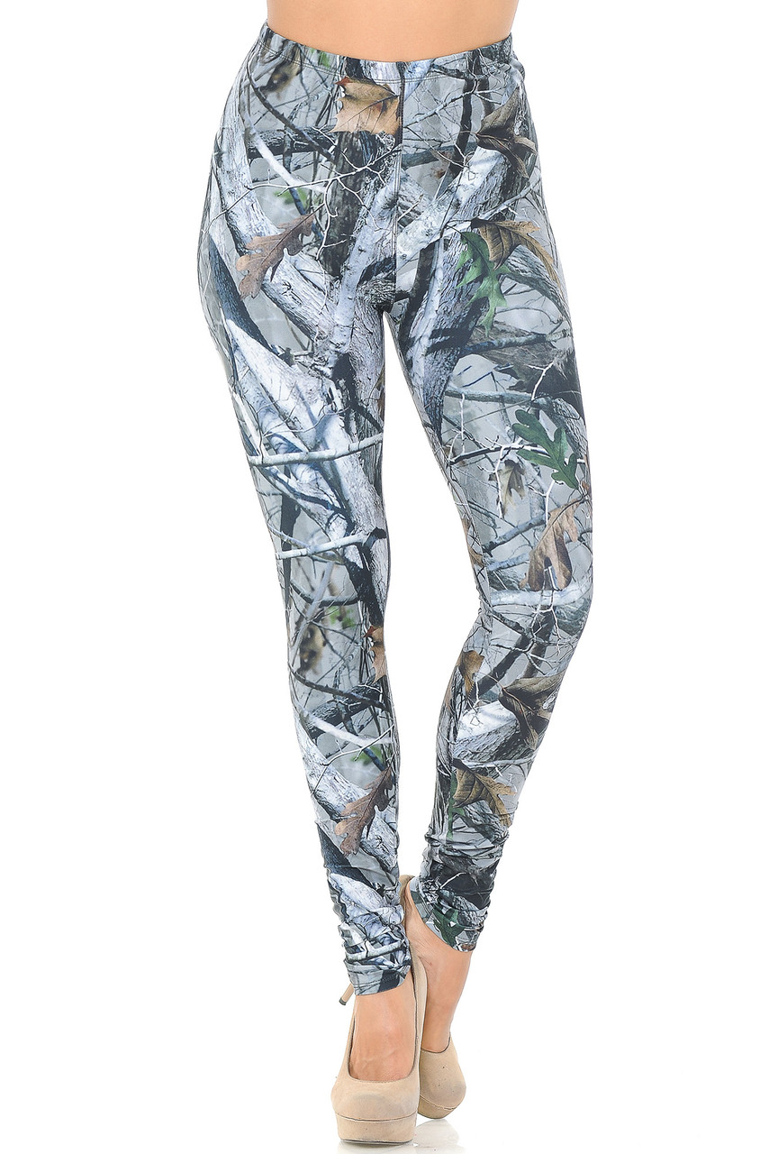 Front view image of our Creamy Soft Camouflage Trees Leggings - USA Fashion™ featuring an elasticized waistband that comes up to about mid rise.