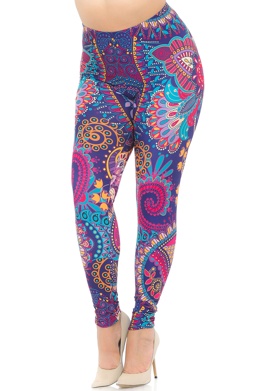 Angled Front view image of our vibrantly coloredCreamy Soft Mandala Flowers Extra Plus Size Leggings - USA Fashion™ with an all over intricate blue, pink, and mustard on purple design featuring mandalas and abstract decorative accents.