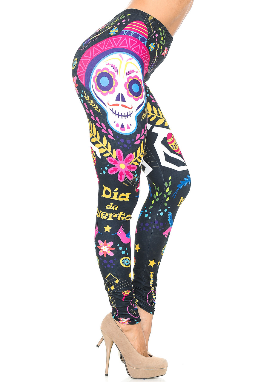"""Right side view image of our Creamy Soft Day of the Dead Leggings  - USA Fashion™ showing a skull the words """"Dia de Muertos"""" and other decorative elements."""