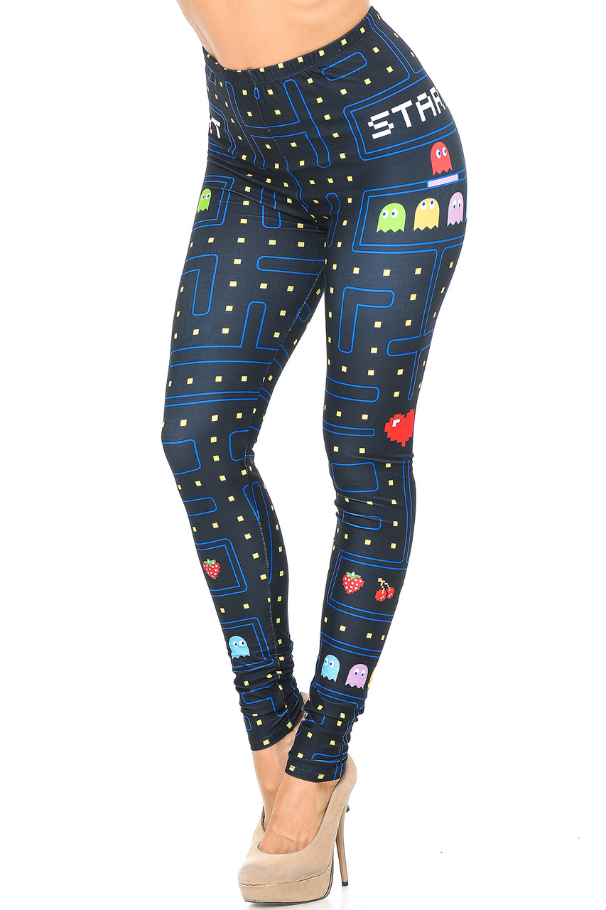 With a cool retro look this is an angled front view image of Creamy Soft Pacman Begins Leggings - USA Fashion™ with a video game inspired design.
