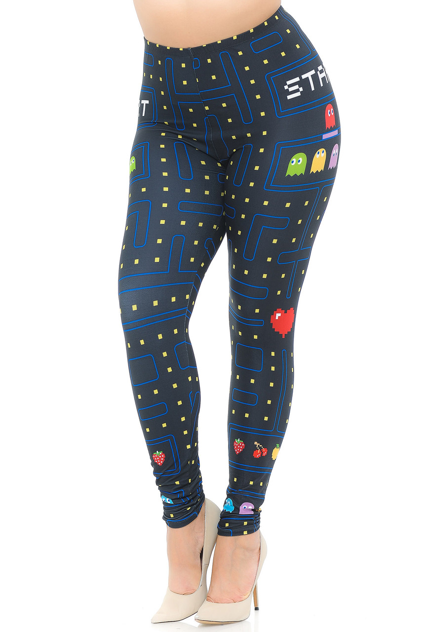 With a cool retro look this is an angled front view image of Creamy Soft Pacman Begins Extra Plus Size Leggings - 3X-5X - USA Fashion™ with a video game inspired design.