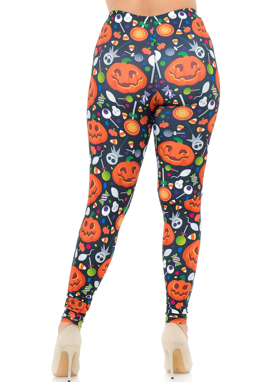 Rear view image of our Creamy Soft Pumpkins and Halloween Candy Plus Size Leggings featuring a super figure flattering body hugging fit.