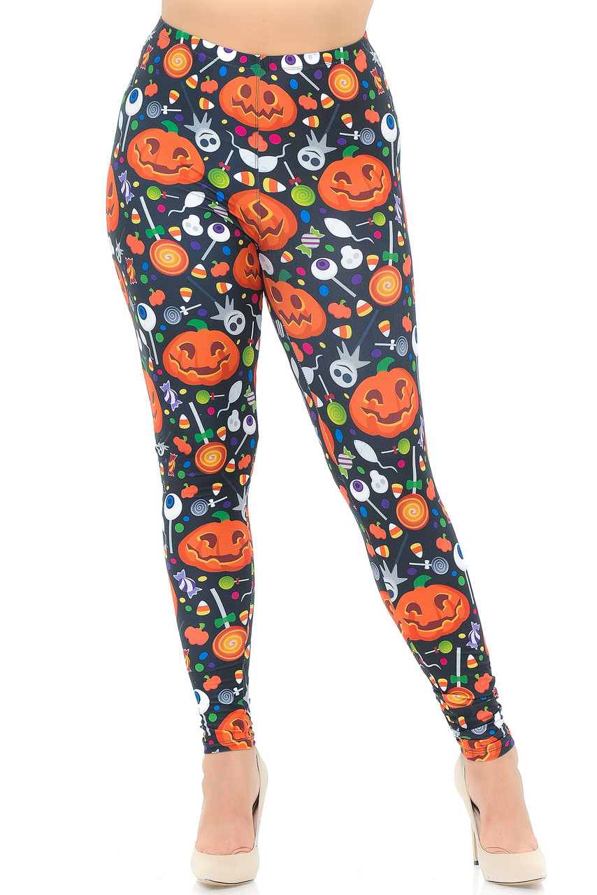 Front view image of our Creamy Soft Pumpkins and Halloween Candy Plus Size Leggings featuring a perfect look for October holiday fashion and a stand out eye-catching look.