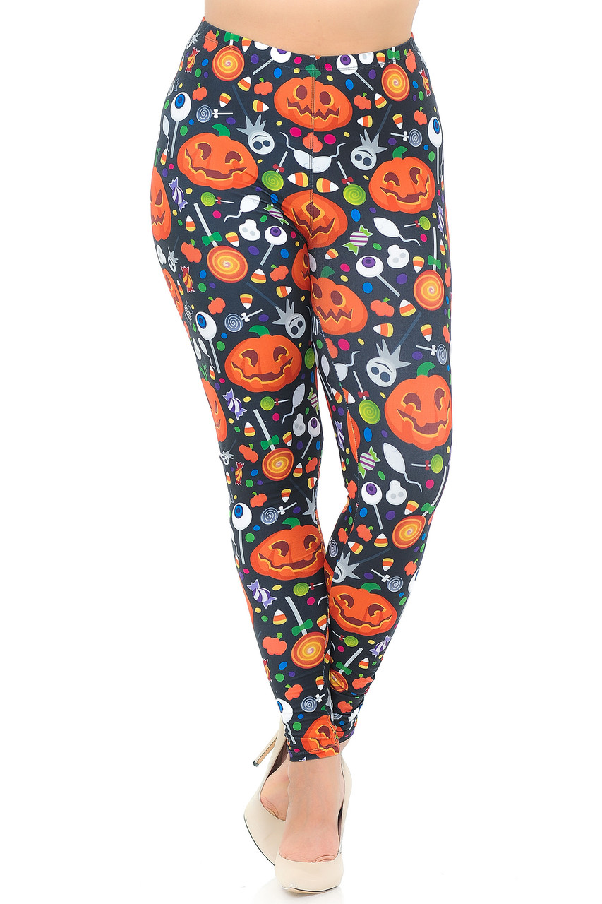 Front view image of Creamy Soft Pumpkins and Halloween Candy Plus Size Leggings with an elastic comfort stretch waist that comes up to about mid rise.
