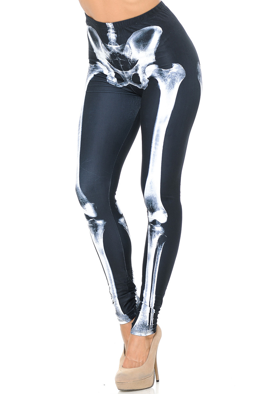 Angled front view image of our Creamy Soft X-Ray Skeleton Bones Leggings - USA Fashion™ with a white on black photorealistic x-ray design perfect for Hallowen or edgy outfits year round.