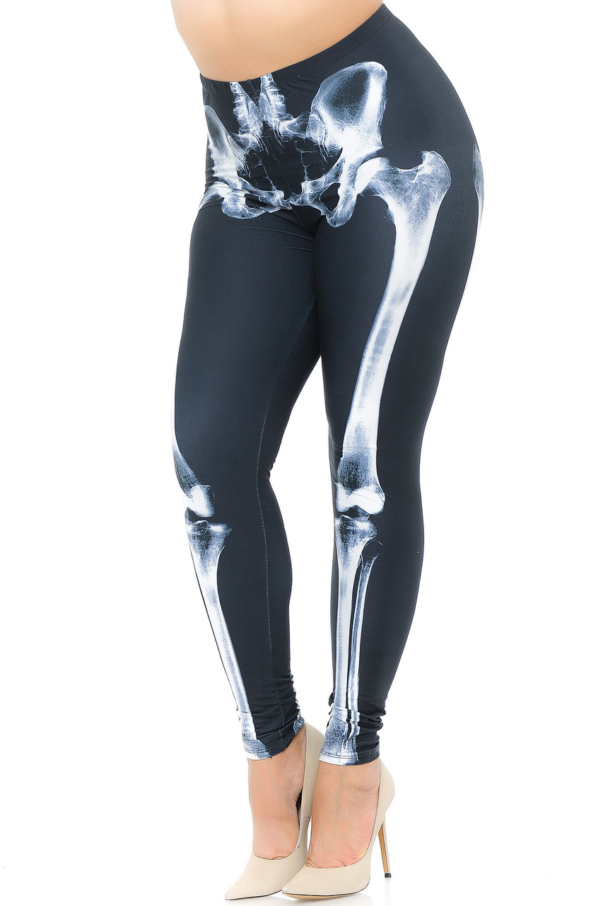 Angled front view image of our Creamy Soft X-Ray Skeleton Bones Plus Size Leggings - USA Fashion™ with a white on black photorealistic x-ray design perfect for Hallowen or edgy outfits year round.