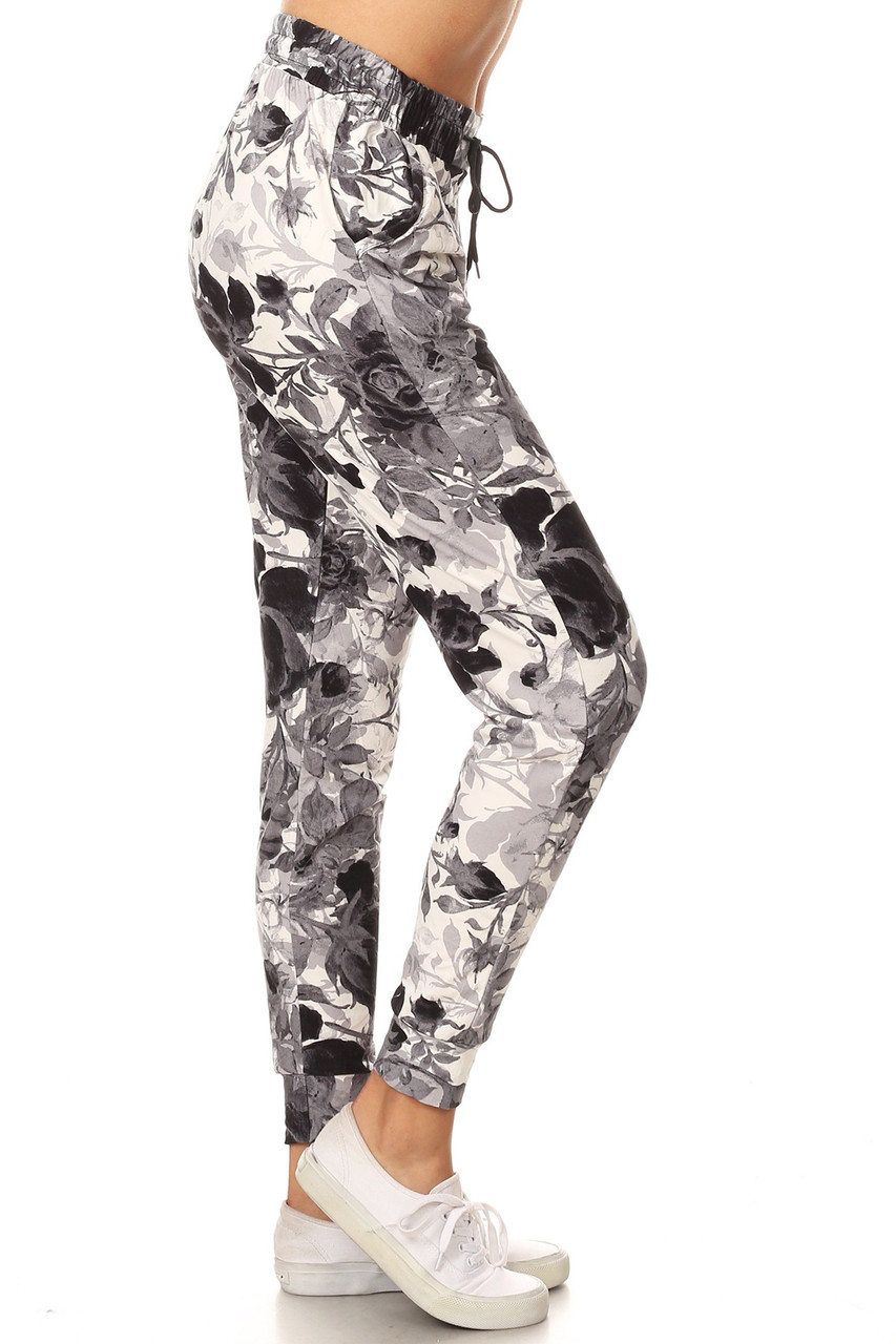 Right side view image of Buttery Soft Black and White Floral Joggers with a neutral gray and charcoal floral design on a white background that gives you a gorgeous yet comfy casual look for any season.