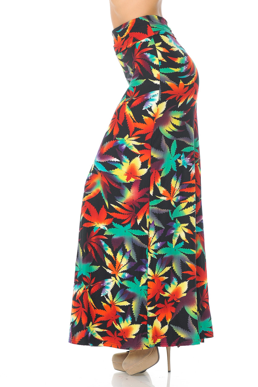 Left side view image of our Buttery Soft Rainbow Marijuana Maxi Skirt featuring a tie-dye filled bright multi colored all over weed leaf print that boldly contrasts a black background for a fun and sassy 420 themed look.
