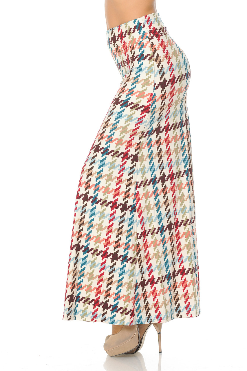 Left side view image of Buttery Soft Earth Tone Pixel Zags Maxi Skirt with a retro muted tone larger scale houndstooth striped design in brown, nude, red, and blue tones on an ivory background.