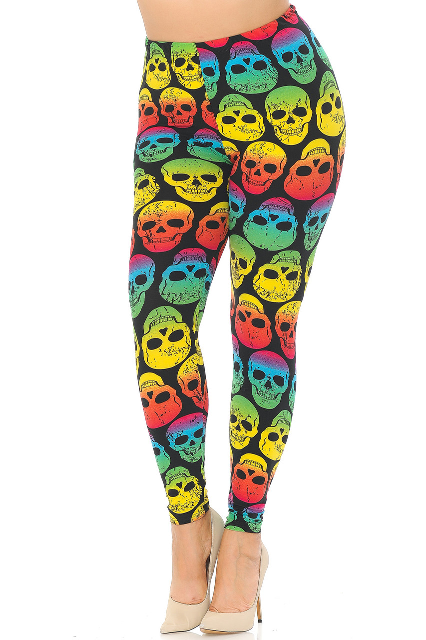 Front view image of our Buttery Soft Rainbow Skull Plus Size Leggings featuring an ombre style bright multi colored all over skull print that boldly contrasts a black background for a fun Halloween or anytime look.