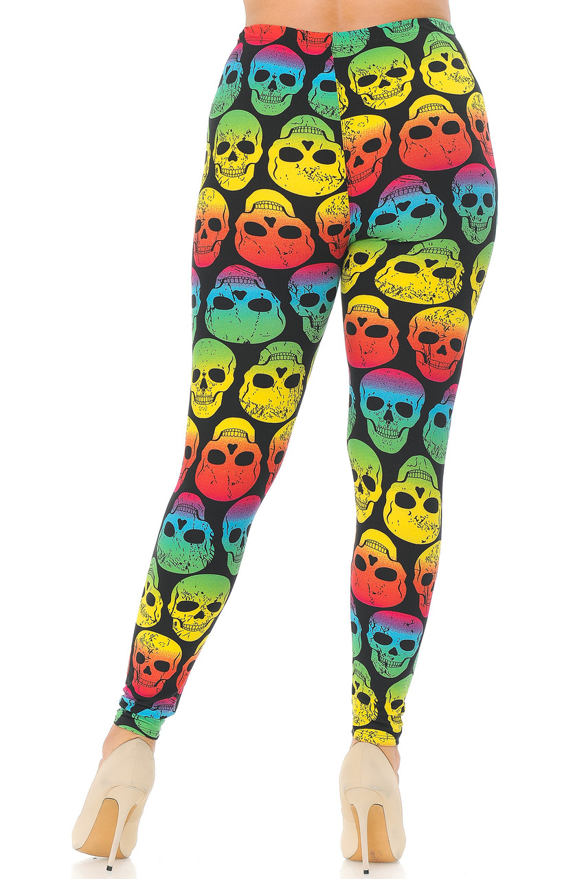 Rear view image of our figure flattering and eye-catching Buttery Soft Rainbow Skull Plus Size Leggings