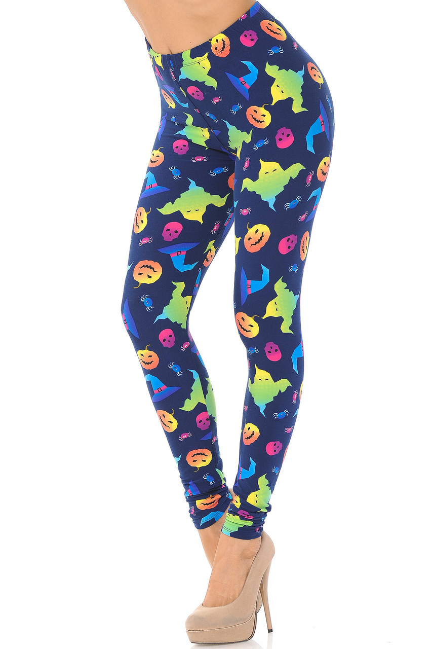 Left side view image of Buttery Soft Ghostbusters Ghosts Halloween Leggings featuring a colorful ombre filled design of ghosts, skeleton, spiders, and pumpkins on a deep blue background.